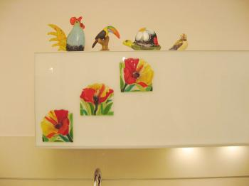 A tile on a kitchen cabinet